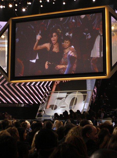 Amy Winehouse receives a Grammy Award