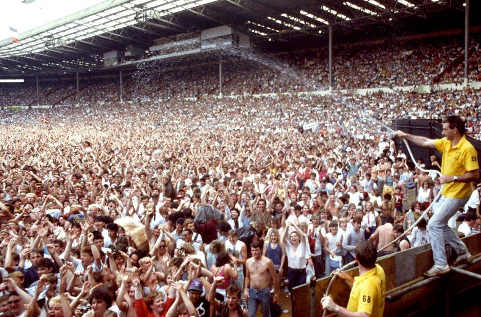 Live Aid Wembley Stadium - hosing down the crowds