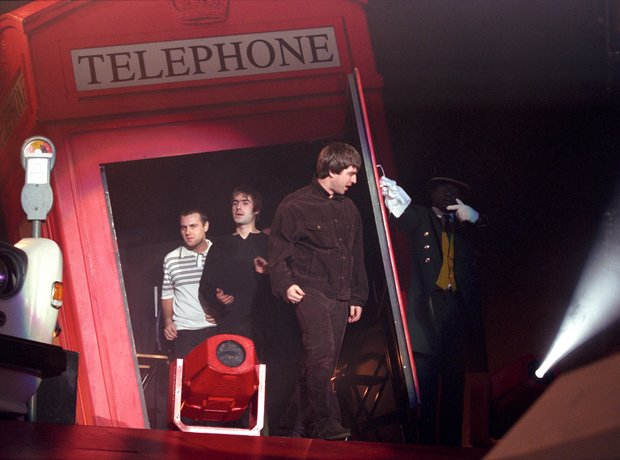 Oasis walk out of London telephone box Wembley 16