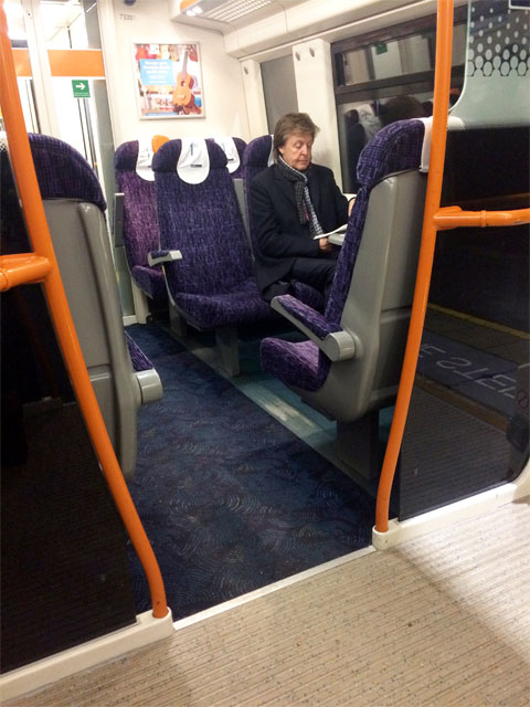 Paul McCartney on the train 480 credit SWNS